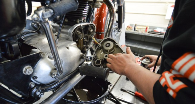 student working on motorcycle