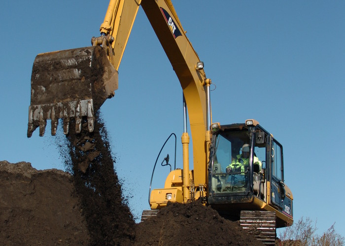 heavy equipment lifting dirt