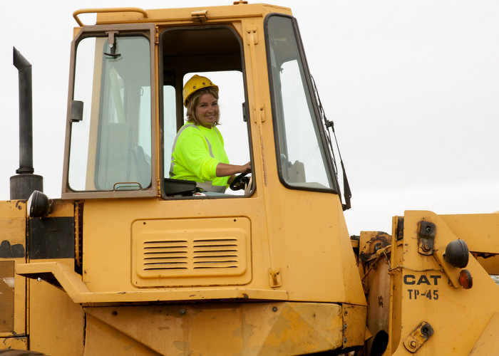 bulldozer with woman student
