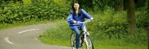 student on bike trail