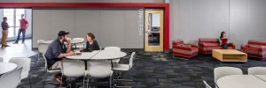 staples campus interior people sitting and talking