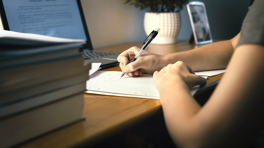 College Or University Student Doing School Homework At Home